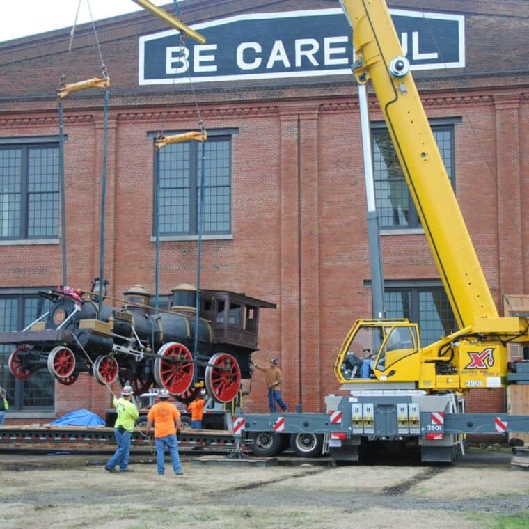 texas locomotive being lifted