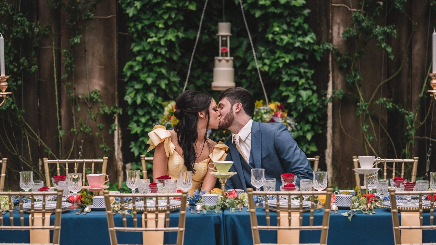 wedding photo of couple sitting at table