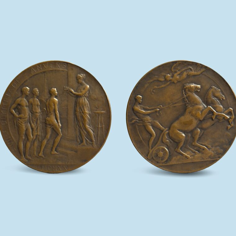Bronze medals with one side with people talking and the other with a person on a chariot with a horse