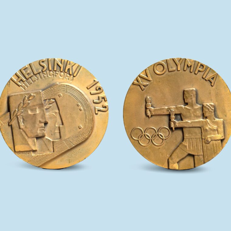 Gold medals with one side that has two faces and says Helskinki 1952 and the opposite two men holding torches, Olympic rings and XV Olympia