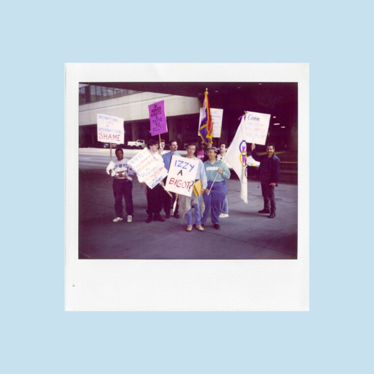Polaroid of people holding protest signs