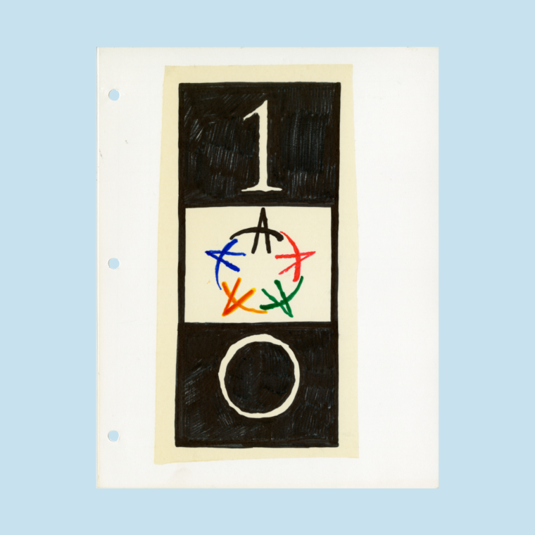 Sketch of Olympic logo with black, red, green, yellow, and blue arrows in the center of two black blocks on white paper on blue background