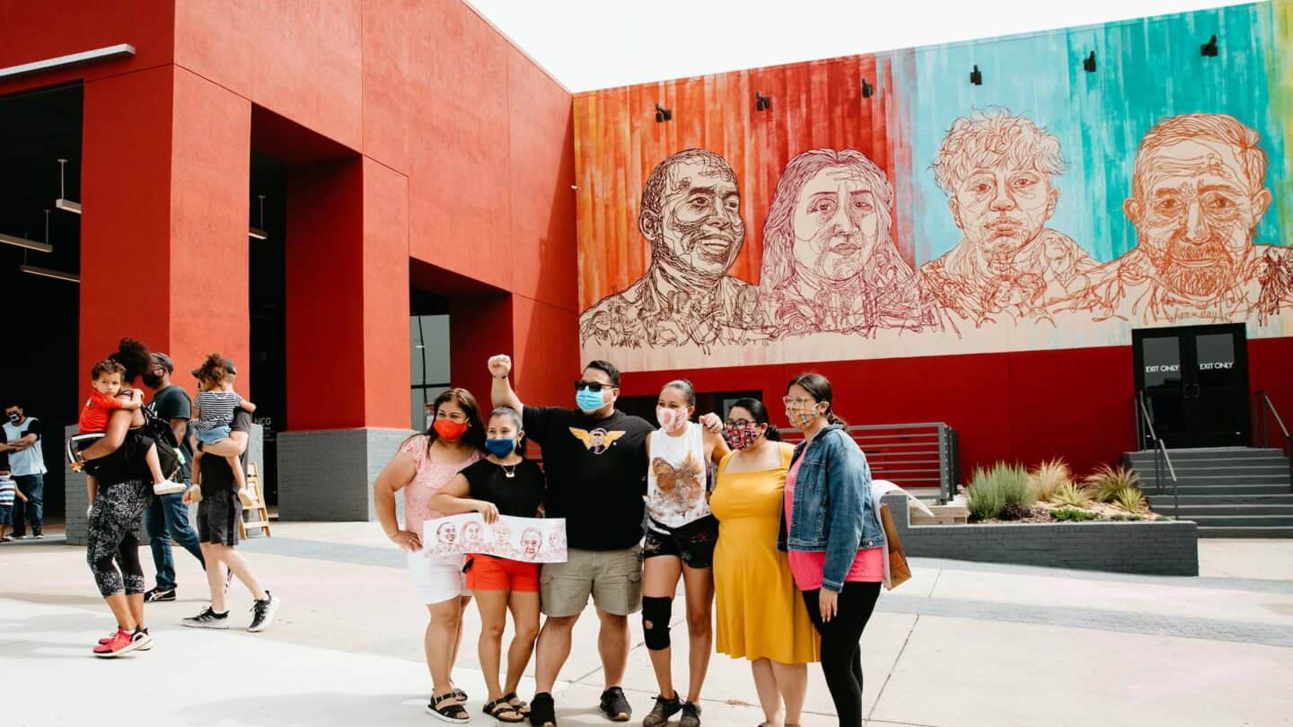 family takes picture with artist/activist