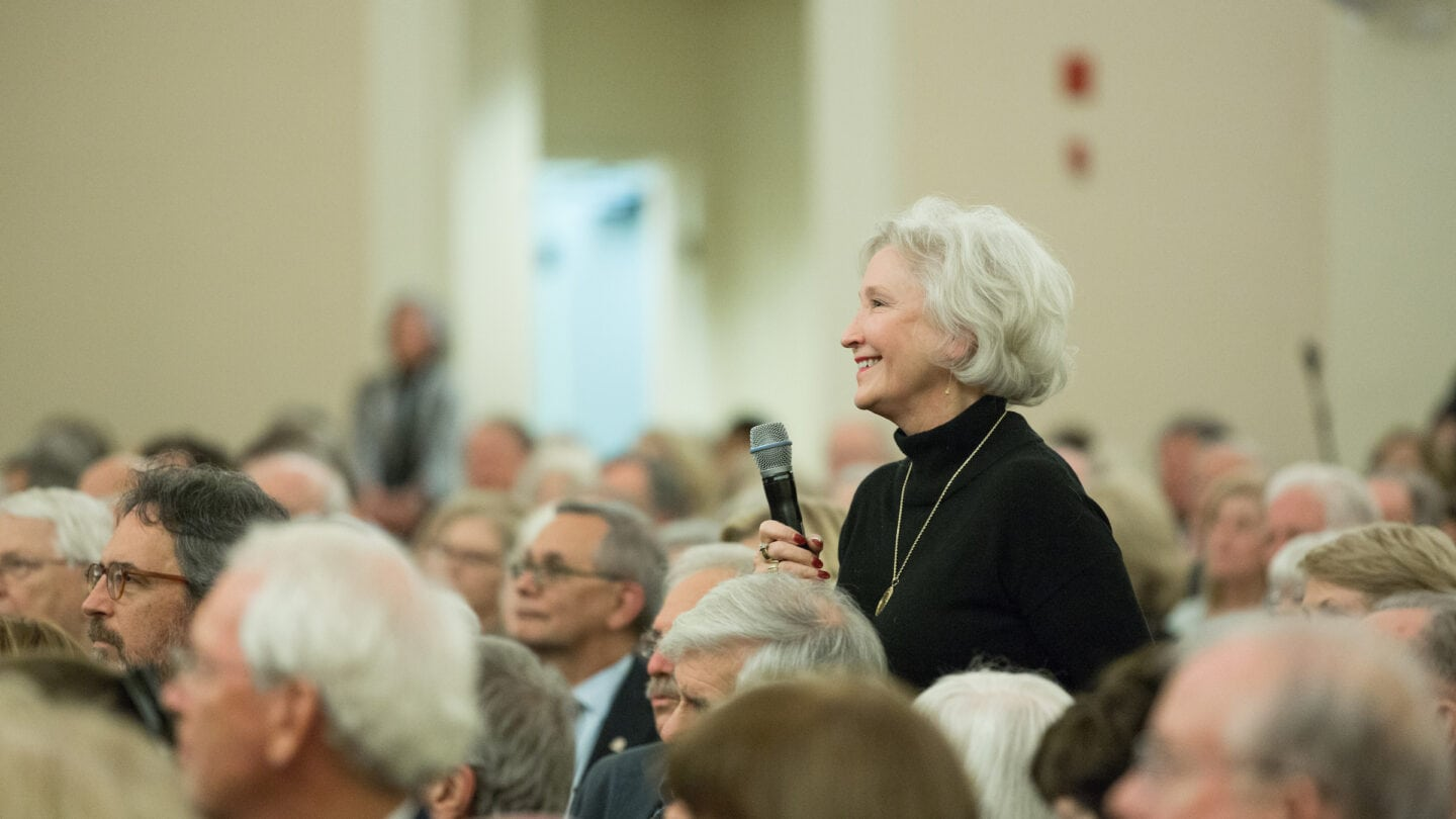 woman asking question at the Ron Chernow, Author Program