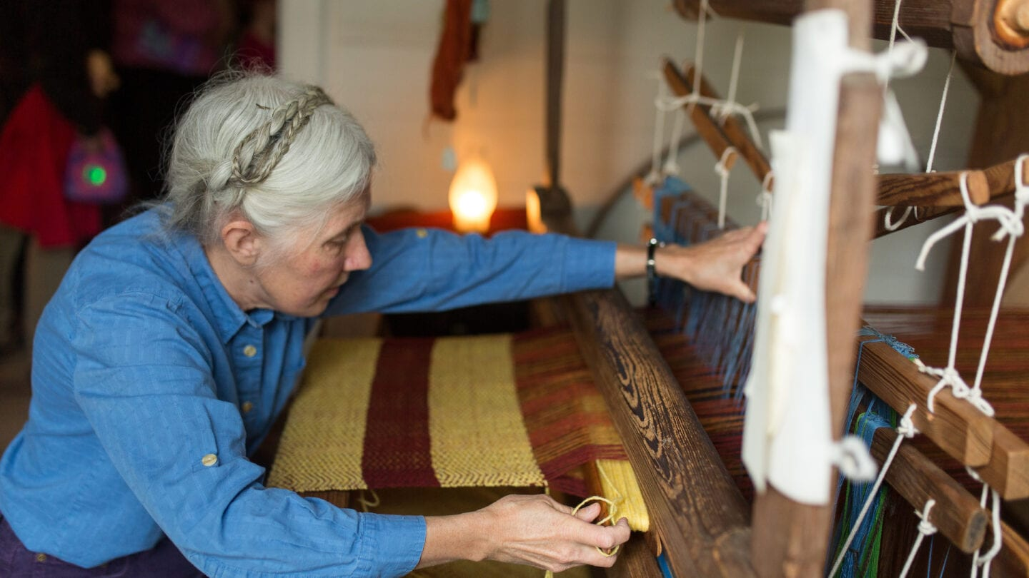 woman working with wool at Sheep to shawl