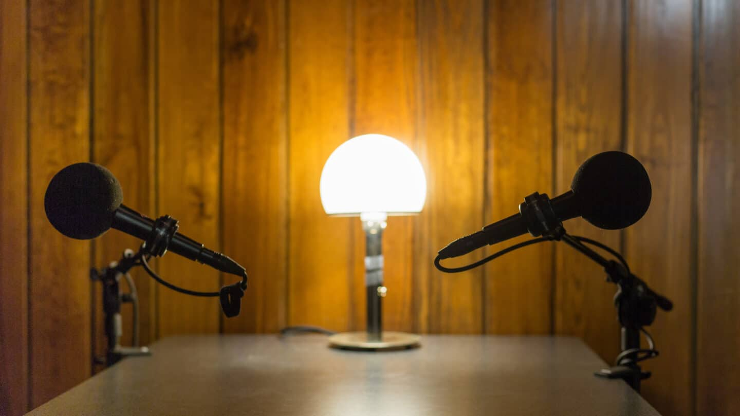 two mics at a table, with lamp