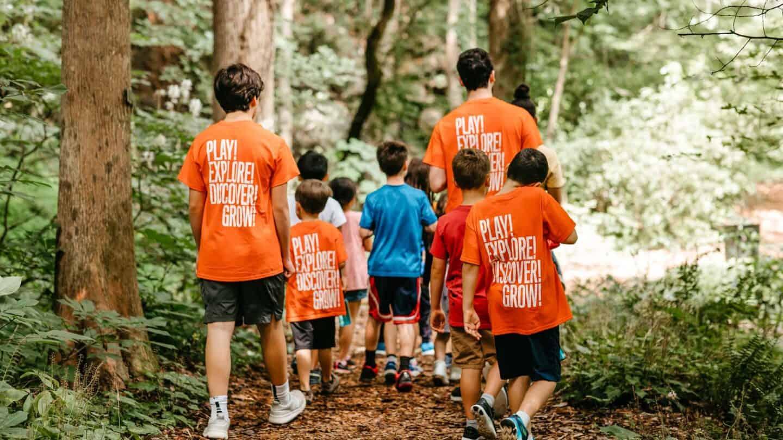 summer camp 2019, kids and volunteers walking