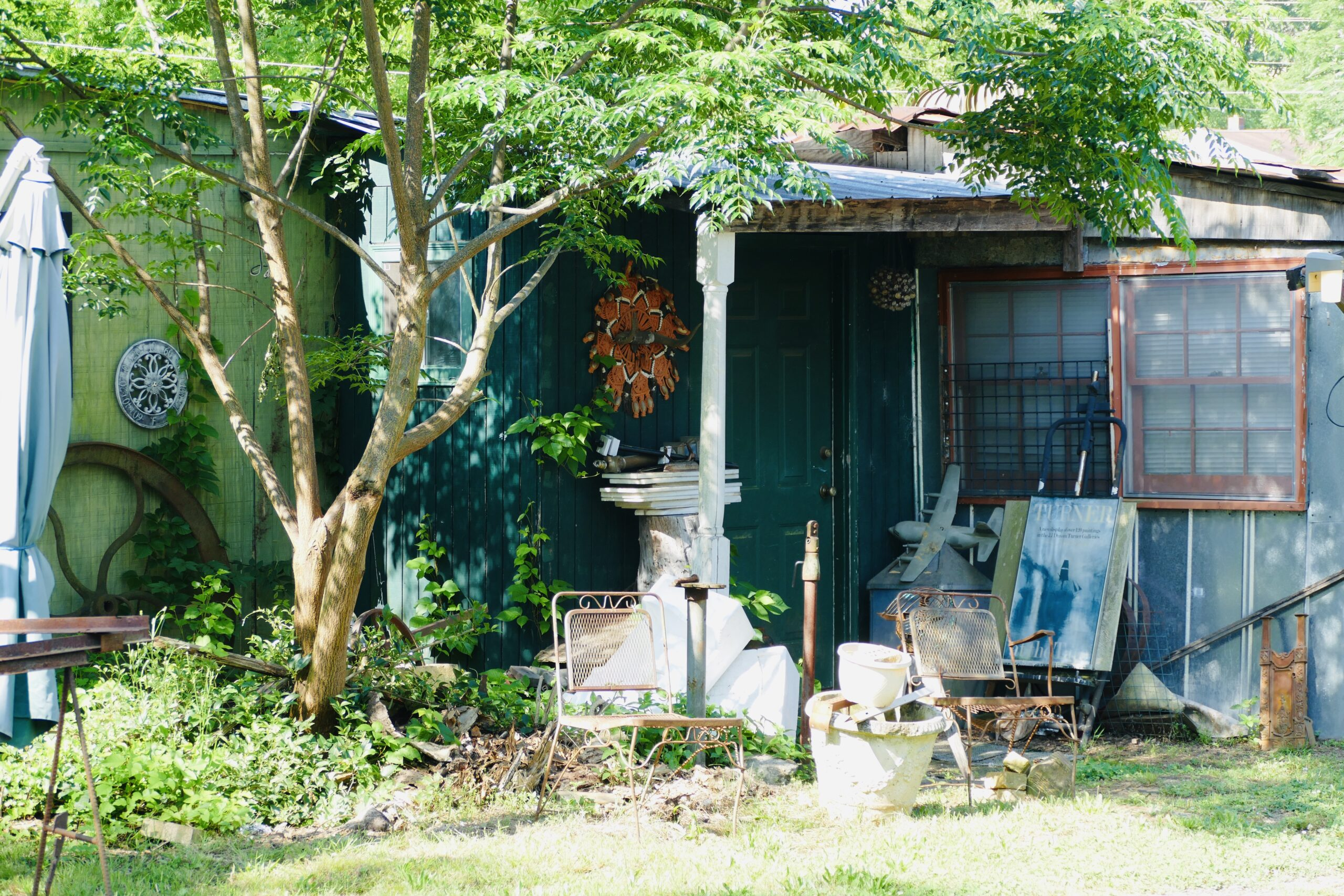 documenting vernacular landscapes during the pandemic, house with many artifacts