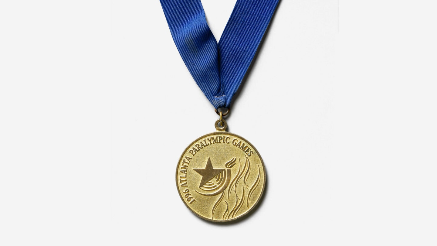 Paralympic gold medal with blue ribbon