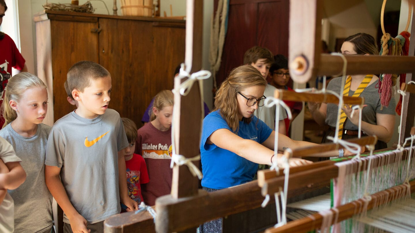 children at summer camp learning about wool