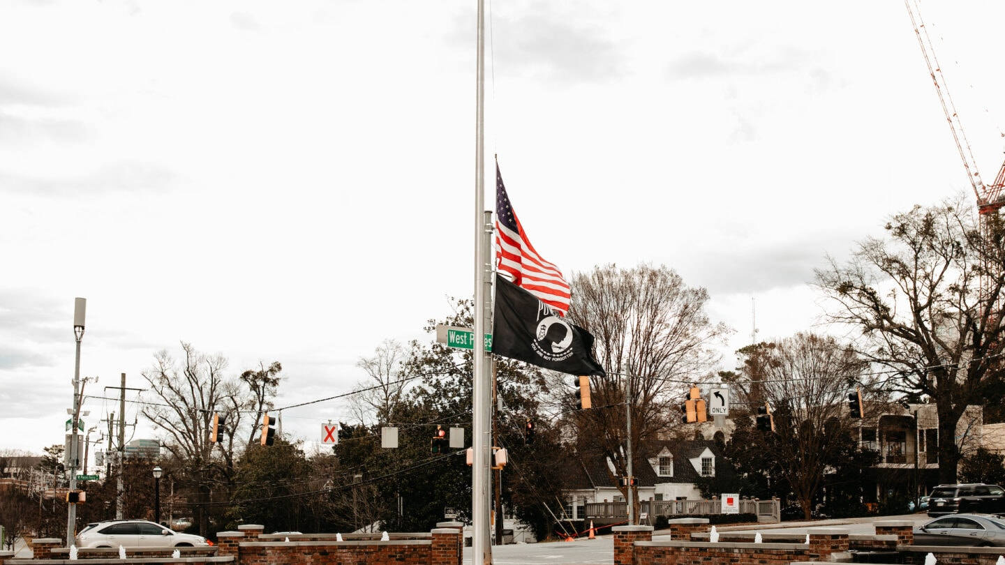 veterans park flags fly half way up the pole