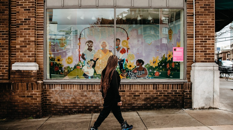 woman walking at Midtown, Heart of the Arts