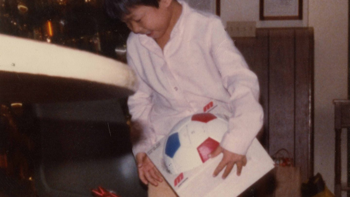 young refugee boy holding a soccer ball