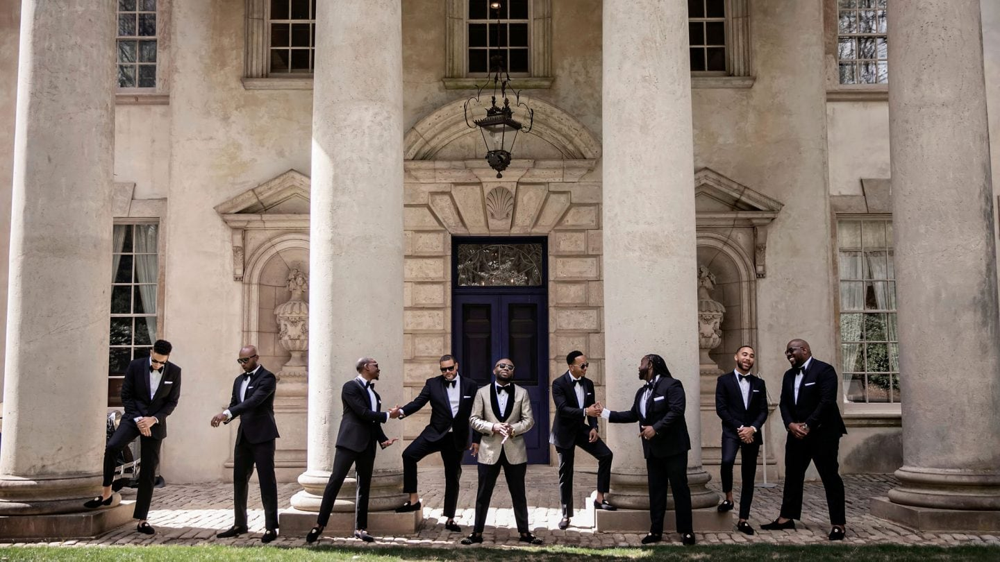 Group of men in suits posing
