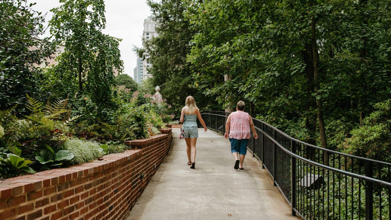 Two people walking in the garden