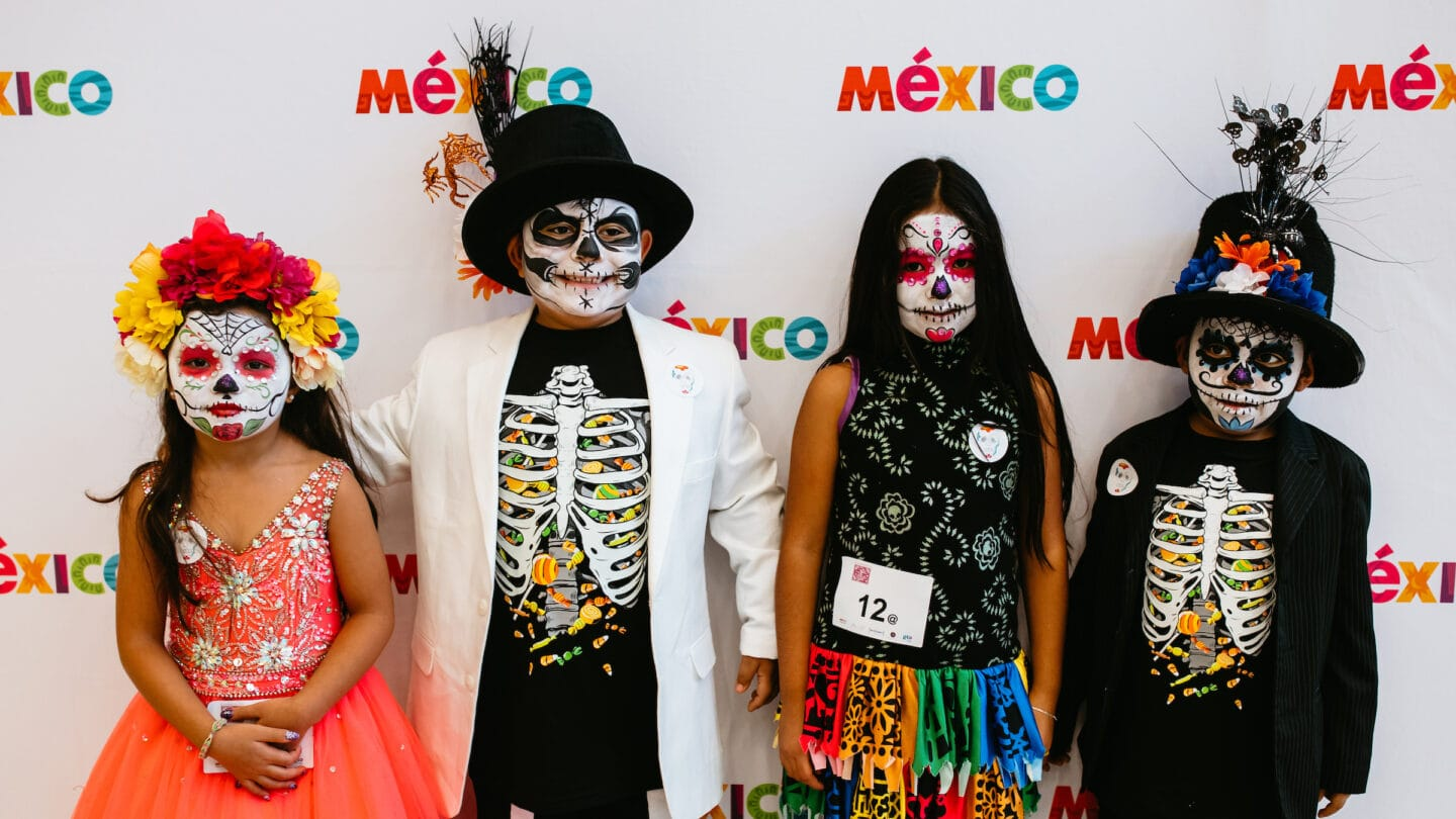 Kids in Day of the Dead costumes